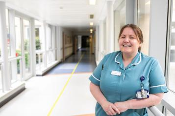 A nurse standing in a hallway in a hospital
