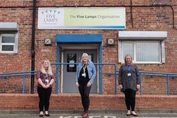 Image of three women stood outside Five Lamps community organisation in Thornaby