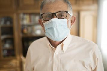 Image of man in a care home wearing a mask