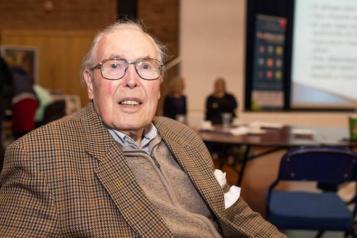 Image of older man sitting down